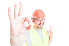 Perfect and professional services concept with joyful constructor royalty free stock images
