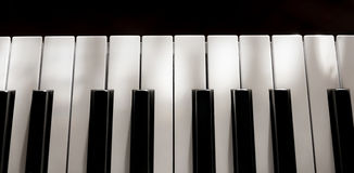 Perfect pure Piano keys mild sunlight soft shadows isolated. Multiple beautiful detailed views of piano keys and notes and sheet music with mild play of the sun stock image