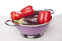 Perfect red peppers and eggplants Stock Photos