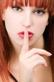 Perfect redhead girl making a silence sign Royalty Free Stock Photo