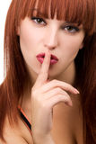 Perfect redhead girl making a silence sign Stock Photos