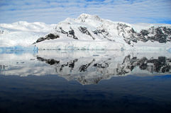 Perfect reflection of antarctica in the ocean. With mountain range Royalty Free Stock Image