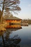 Perfect reflection - boathouse on small lake Stock Images