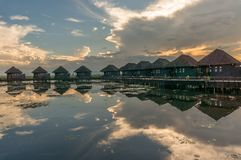 Reflection on Inle Lake, Myanmar. Perfect reflection of holiday resort on stilts in Inle Lake, Myanmar Royalty Free Stock Photography