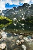 Perfect reflection in Morskie Oko lake in tatra range Poland Royalty Free Stock Images