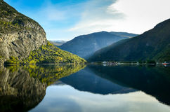 Perfect reflection of mountains in clear fjord Royalty Free Stock Image