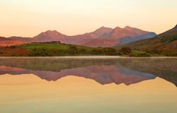 Free Perfect Reflection Of Mountains Glowing With The Sunrise In A Lake Royalty Free Stock Image - 161082266