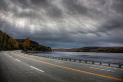 Perfect road along a river. In quebec canada Stock Photography