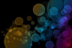 Perfect round bokeh background. With yellow, orange, blue, green and purple tone on black ground Royalty Free Stock Photo