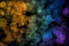 Perfect round bokeh background. With yellow, orange, blue, green and purple tone on black ground Stock Photos