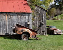 Perfect Rust. Old rusty car, old truck bed, old tobacco barn, wagon wheel, and bird house. Appalachian Mountains Stock Photos
