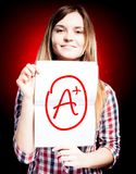 Perfect school grade A plus of exam and happy girl royalty free stock photography