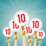 Perfect Score. Vector illustration of several hands holding perfect 10 score signs Stock Images