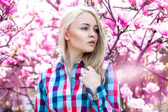 Perfect serious cute blonde looking away with fowers Stock Images