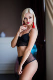 Perfect, sexy body, belly and breast of young blonde woman wearing seductive lingerie. Beautiful hot female in underware Royalty Free Stock Image
