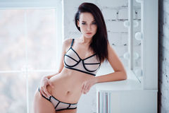 Perfect, sexy body, belly and breast of young woman wearing seductive lingerie. Beautiful hot female in underware posing Stock Photo