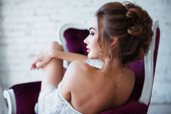 Perfect, sexy body, legs and ass of young woman wearing seductive lingerie. Sensual girl posing on sofa in erotical way Royalty Free Stock Photography