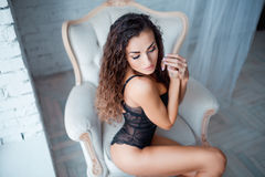 Perfect, sexy body of young woman wearing seductive lacy black lingerie Stock Photography