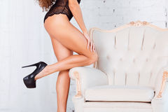 Perfect, sexy legs and ass of young woman wearing seductive black lingerie Stock Photos