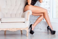Perfect, sexy legs and ass of young woman wearing Stock Photography