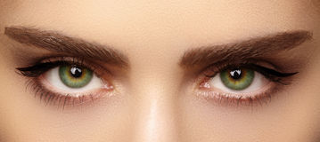 Perfect shape of eyebrows and extremly long eyelashes. Macro shot of fashion eyes visage. Before and after