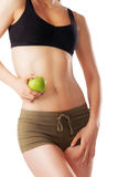 Perfect shaped woman holding green apple in hand Stock Image
