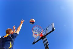 Perfect shoot. Teens shoot perfectly to the basket Royalty Free Stock Images