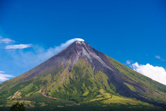 Perfect Shope Cone Volcano Smoking. Mayon Volcano a perfect cone shape in Legaspi, Southern Luzon, Philippines royalty free stock image