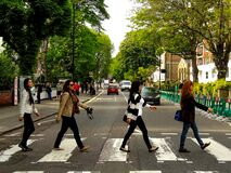 Free Perfect Shot Of Four The Beatles Fans Walking Across The So Famous Abbey Road Zebra Crossing Royalty Free Stock Photo - 175109025