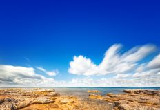 Perfect sky and water of ocean Stock Photos