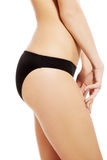 Perfect slim and supper female buttocks in black panties. Stock Photo