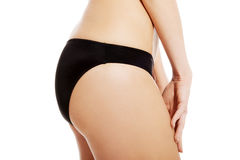 Perfect slim and supper female buttocks in black panties. Royalty Free Stock Images