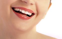 Perfect smile. Beautiful smile of a woman over white background Stock Photography