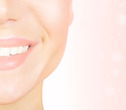 Perfect smile. With white healthy teeth, closeup on beautiful female face, dental care concept Stock Images