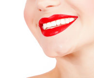 Perfect smile. Photo of perfect girls smile, closeup of female face part isolated on white background, sexy red lipstick, dental health care, healthy teeth Royalty Free Stock Images