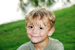 Perfect Smile. Handsome Boy showing off his perfect smile. He has blonde hair and brown eyes royalty free stock photos