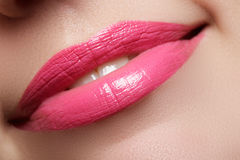 Perfect smile. Beautiful full pink lips and white teeth. Pink lipstick. Gloss lips. Make-up & Cosmetics Royalty Free Stock Photography