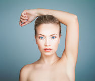 Perfect Spa Model Girl with Healthy Skin on Blue Background. Spa Beauty Portrait Royalty Free Stock Images