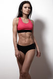 Perfect sports female model. Healthy lifestyle, diet and fitness Stock Photography