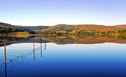 Perfect and still lake reflecting the Yorkshire Dales. Stock Photos