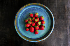 Perfect Strawberries on blue plate Stock Image