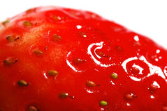 Perfect strawberry closeup. Macro shot of a perfect red strawberry Royalty Free Stock Photography