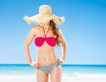 Healthy woman on beach hide behind straw hat. Perfect summer. healthy woman on the beach hide behind straw hat Stock Images