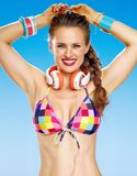 Smiling woman with headphones on beach Royalty Free Stock Photography