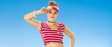 Portrait of smiling young woman in red sun visor on seacoast Stock Images