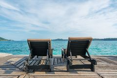 Perfect summer tropical paradise beach with lounge chairs at resort in Phuket, Thailand. Vacation summer holidays and travel. Concept royalty free stock image