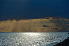 Perfect sunset on the sea, with radiant rays of sun over a warm colourful horizont. Royalty Free Stock Images
