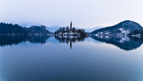 Perfect symetry of a lake and church on small island. Perfect symetry of a lake Bled with church on small island, Slovenia Royalty Free Stock Images