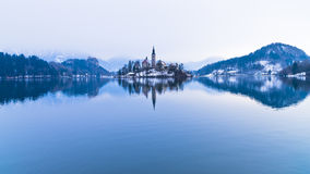 Perfect symetry of a lake and church on a small island, Bled, slovenian alps. Slovenia Royalty Free Stock Photo