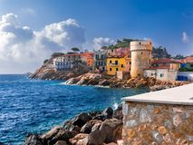 The perfect tiny seaside village of Giglio Porto with multi colored houses royalty free stock image